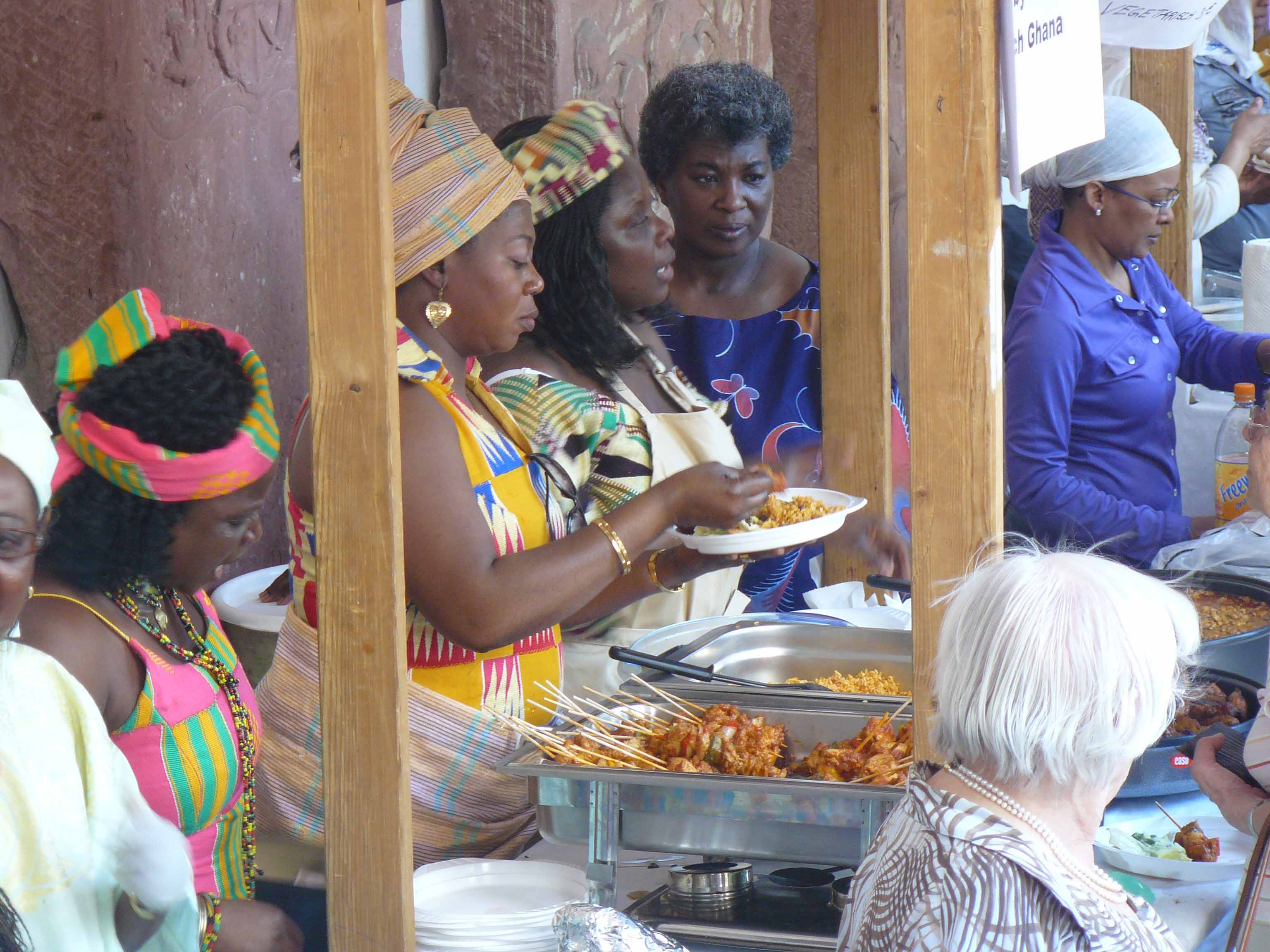 Selling ghanaian dishes at the International Pentecostal Festival.