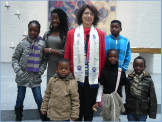 Rev. Kreider with some members of our Children's Service.